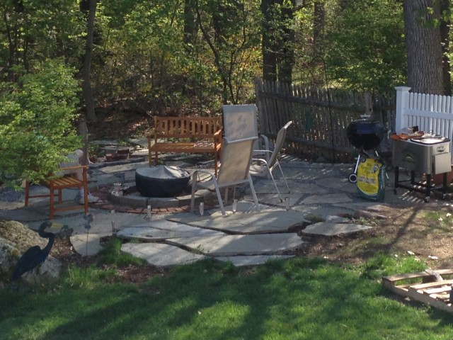 That's the fire pit we built last year. One of these days we'll get around to replacing the 30 year old length of cedar fence, but honestly, no one notices.